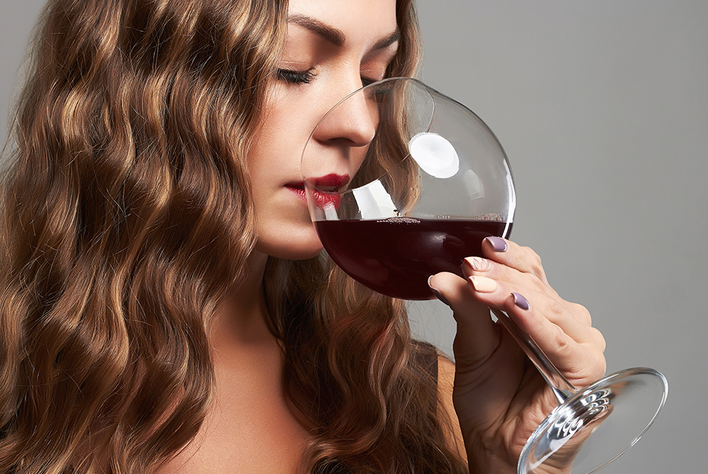 gorgeous lady with glass of red wine.Beautiful woman drinking red wine